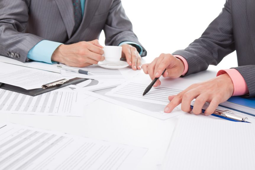 Business lawyer and client drafting documents