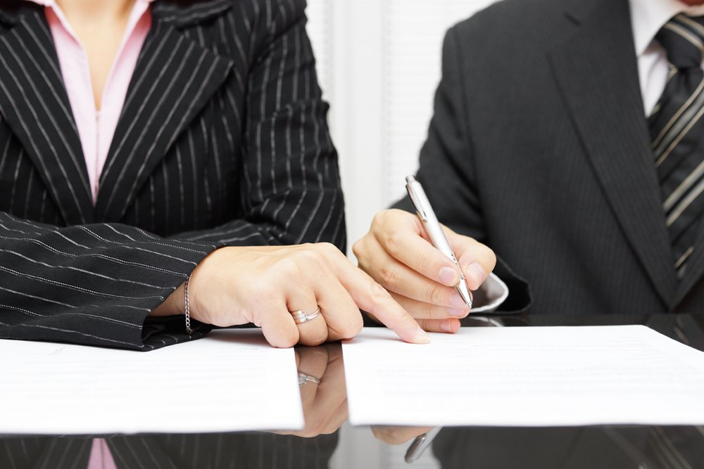 Business Lawyer Reviewing Paperwork With Client