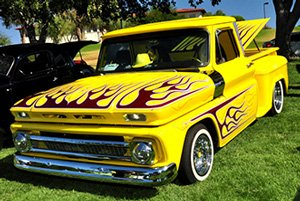 Yellow Chevy truck with flames