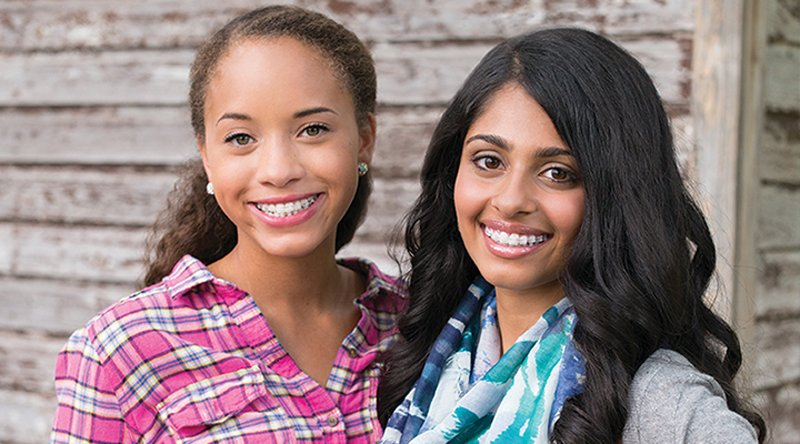 two young women with braces smiling - Idaho Falls orthodontic treatment