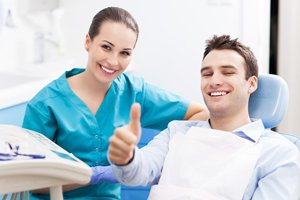 happy dental patient with dental hygienist