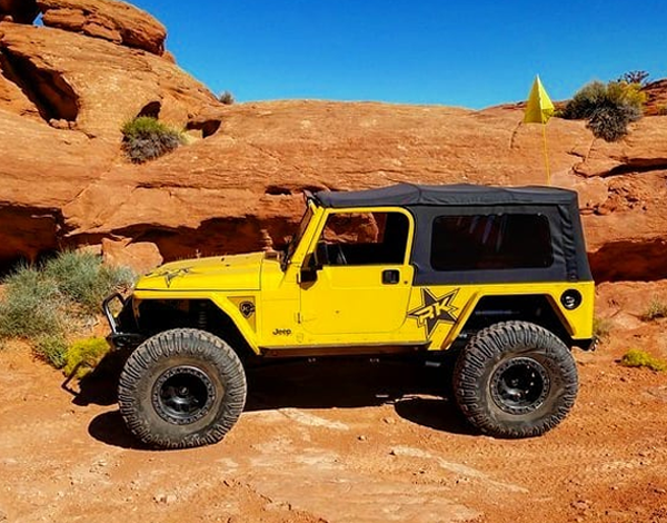St. George off-road parts - yellow jeep in the desert