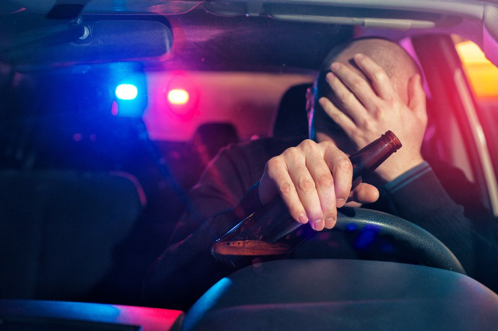 person being pulled over with a beer in hand - Missouri ignition interlock device