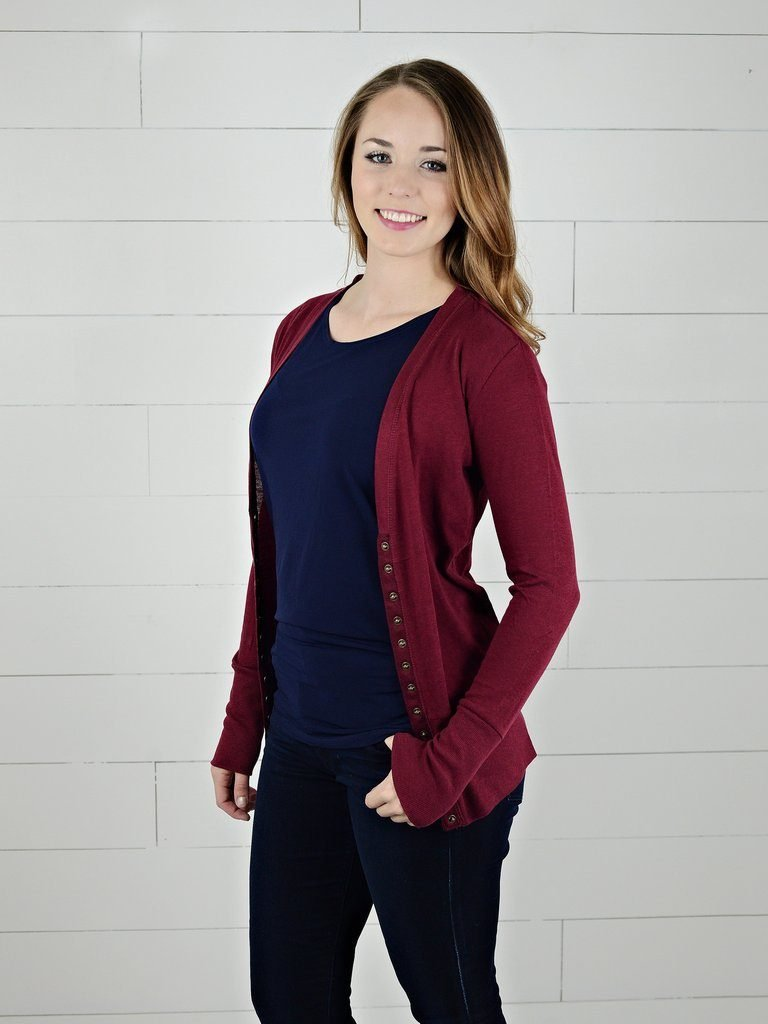 young woman wearing a maroon cardigan - modest clothing