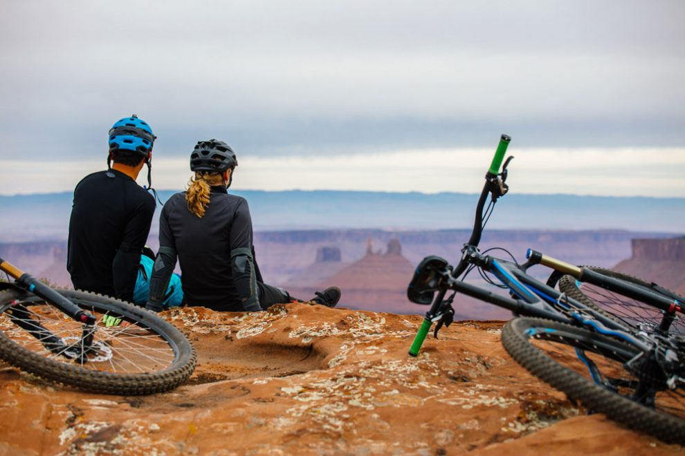 two people resting with their bicycles