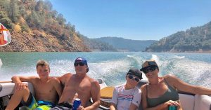 happy family on boat on the lake