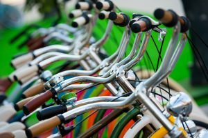 row of bicycles handlebars
