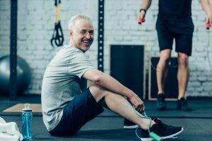 man at gym smiling