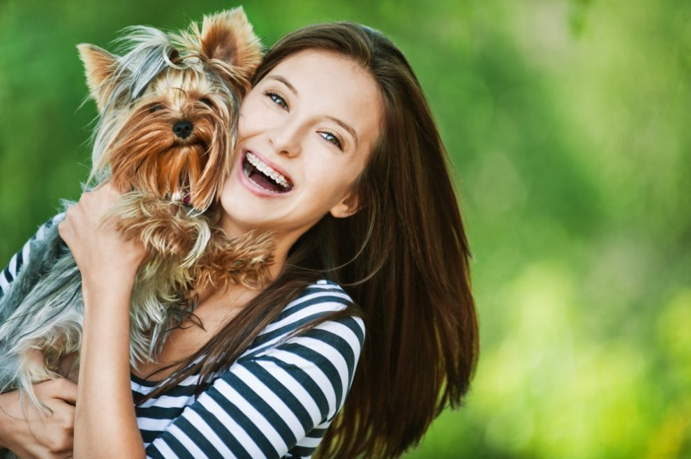 dog with happy lady - 8 Ideas to Save Money as a Dog Owner