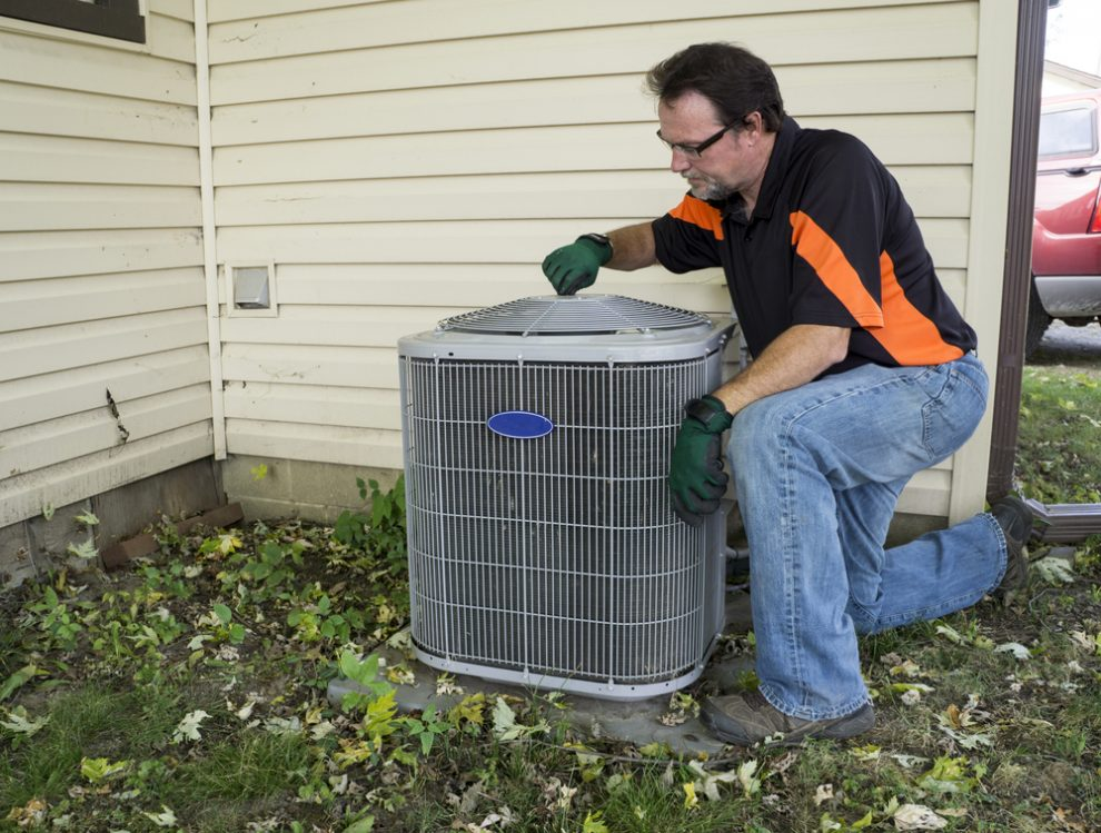 Man performing spring cleaning on St. George HVAC