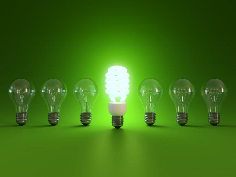 Energy Saving Light Bulb next to traditional light bulbs