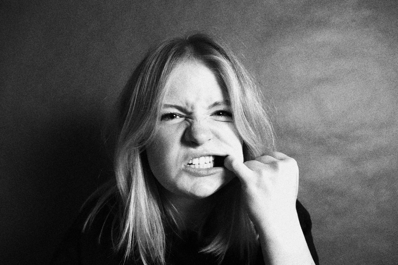 woman holding her mouth open